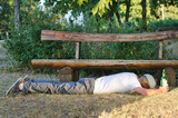 Drunk man sleeping it off in a park