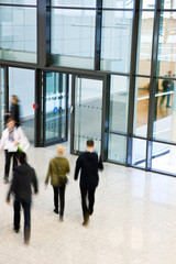 Unrecognizable People Walking in Modern Corridor, Motion Blur