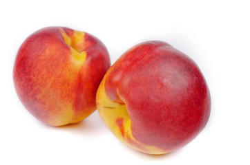 Close up of a two ripe nectarines