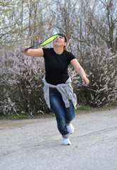 Attractive woman playing badminton