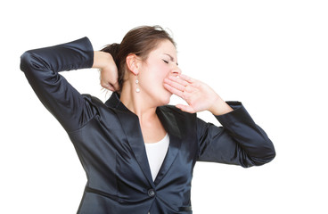 Sleepy business woman yawning and stretching, isolated
