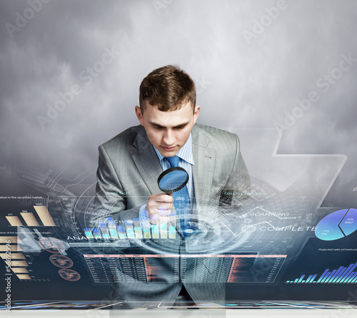 Man looking in magnifier