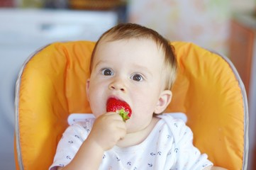 lovely baby age of 1 year tastes strawberry