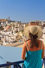 woman enjoying view of Santorini, Greece