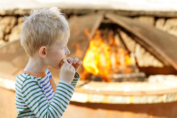 boy eating smores