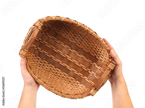 Hand holds vintage weave wicker basket