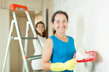 women  making repairs at home