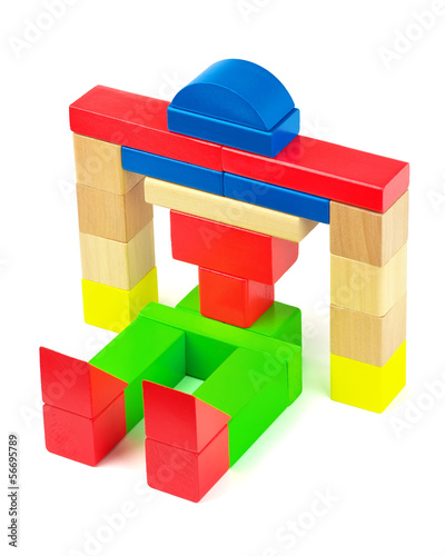 Toy robot made from toy wooden bricks on white background