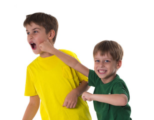 younger brother hits the older with fist