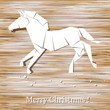 Horse origami made of paper on wood background.