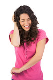 Laughing brown haired woman gesturing