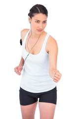 Serious fit model jogging