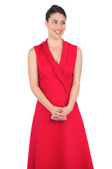 Curious elegant model in red dress posing
