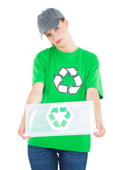 Stern pretty environmental activist holding an empty recycling b