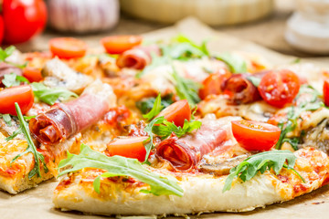 Baked pizza with fresh vegetables