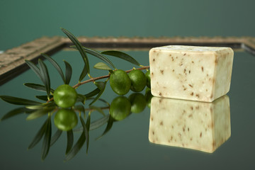 Handmade olive soap with olive branch.