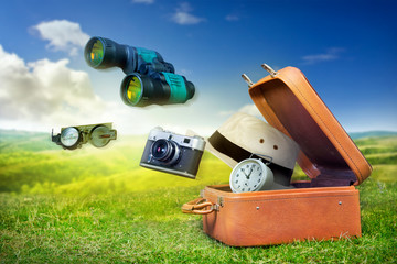 Luggage of an adventurer, travel concept background