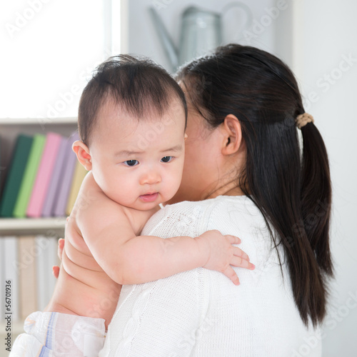 Poster Mother pampering baby