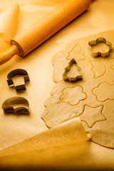 Cutting of different shapes of gingerbread cookies