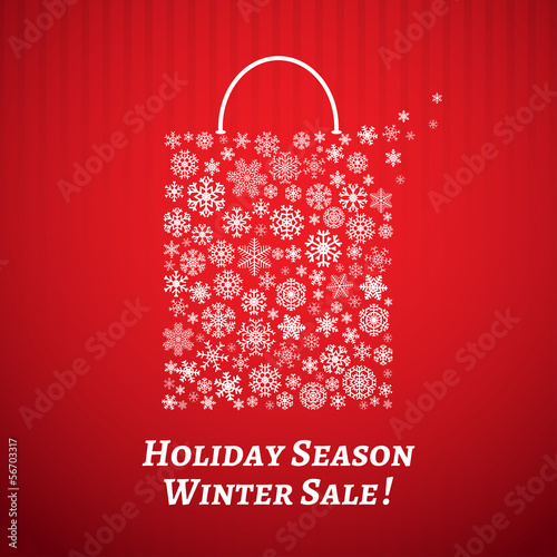 Christmas background with a shopping bag from white snowflakes