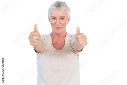 Mature woman smiling at camera giving thumbs up