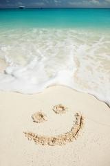 "Symbol ""smile"" on beach background"