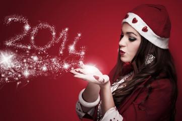 Cute Santa woman blowing New Year 2014
