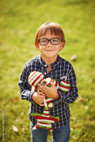 Smiling boy carrying Christmas decor