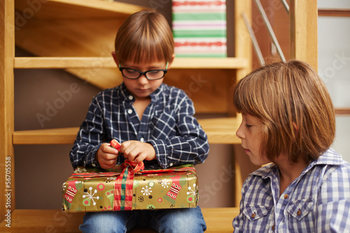 Boy unwrapping a Christmas present