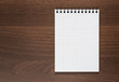 Blank notepad at wooden desk with copy space