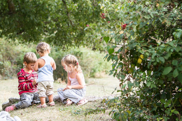 three happy children enjoying their time outdoors