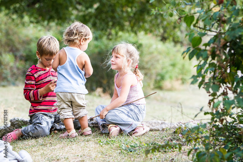 three happy children enjoying their time outdoors