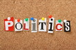 The word Politics on a cork notice board