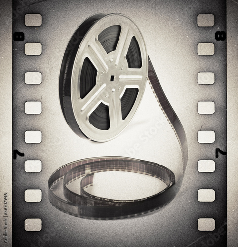 Deurstickers Retro Old motion picture film reel with film strip. Vintage background