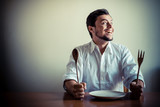 young stylish man with white shirt eating in mealtimes