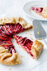 Sweet fruit tart plum galette pie cut into slices