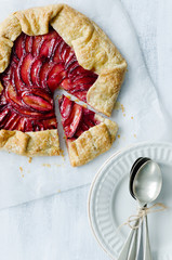Serving plum galette, shot from overhead