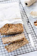 Healthy loaf of bread full of different seeds and nuts