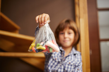 Little girl holding a bag of candy