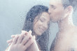 Loving couple in shower. Beautiful loving couple hugging while s