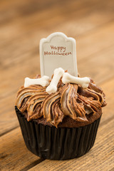 Halloween cupcake with tombstone topper close-up