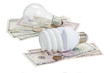 energy saving and normal   bulbs on dollars