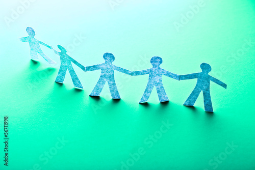 Paper people in teamworking concept