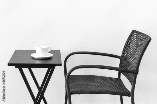 Chair, table and teacup