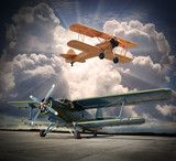Retro style picture of the biplanes. Transportation theme.