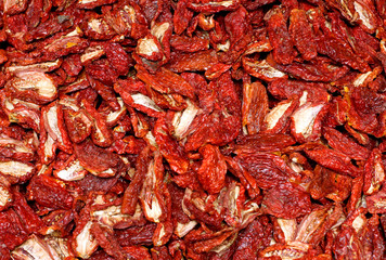 dried red ripe tomatoes for sale at vegetable market