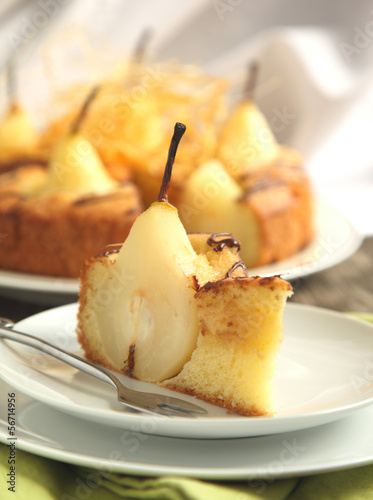 Piece of cake with pears with spun sugar strands. Selective focu