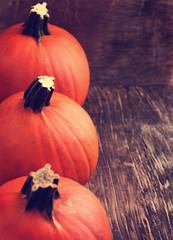 Pumpkins on wooden background, toned