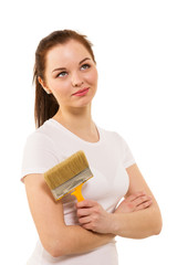 The smiling woman in white t-shirt with brush in hand is ready t