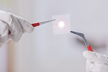 Scientific showing a piece of graphene with hexagonal molecule.